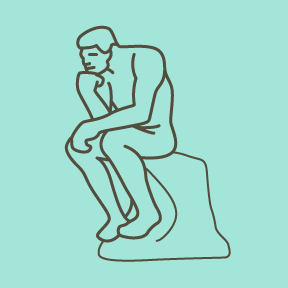 Man sitting on a rock with his fist on his chin.